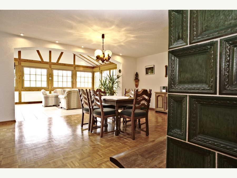 Wohnzimmer mit Wintergarten - Ferienwohnungen Heisterholz